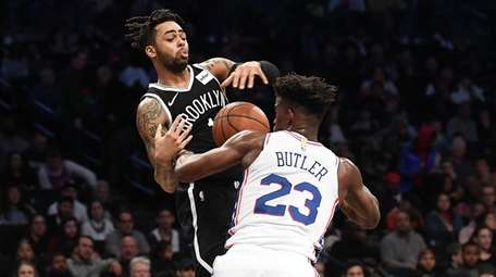 D'Angelo Russell of the Nets is fouled by