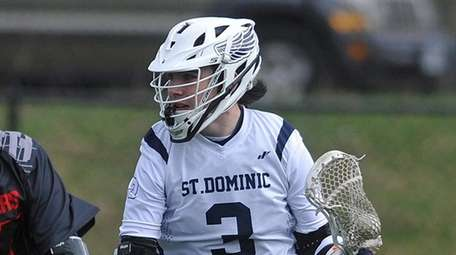 Jack Rooney of St. Dominic, right, gets pressured