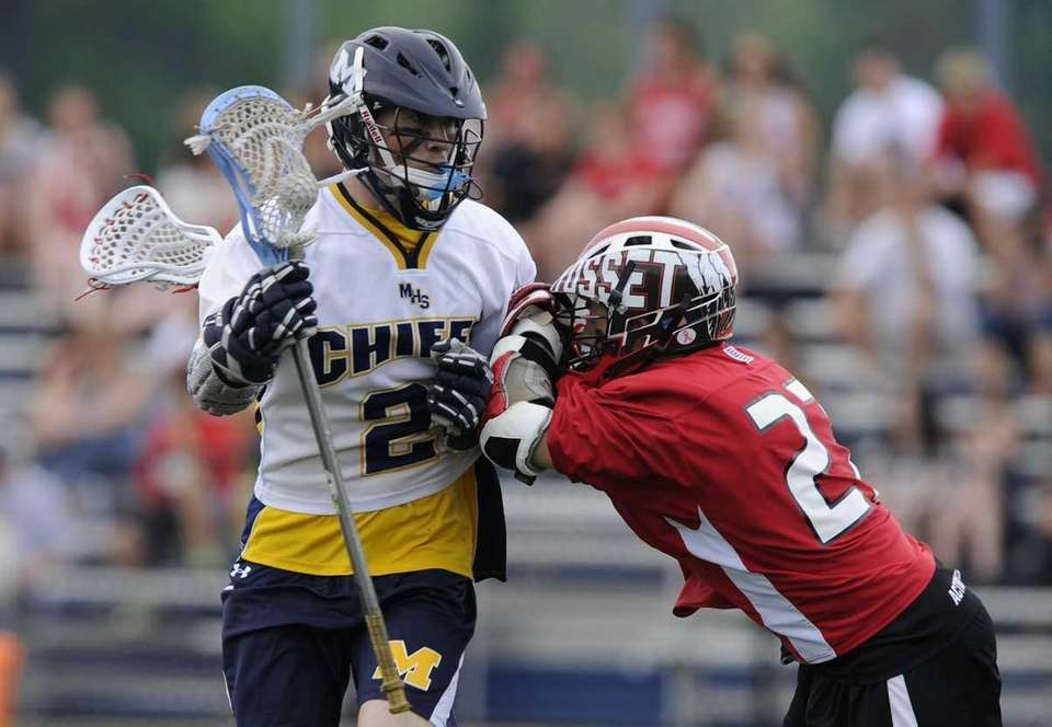 Massapequa midfielder Dan Muller protects the ball from