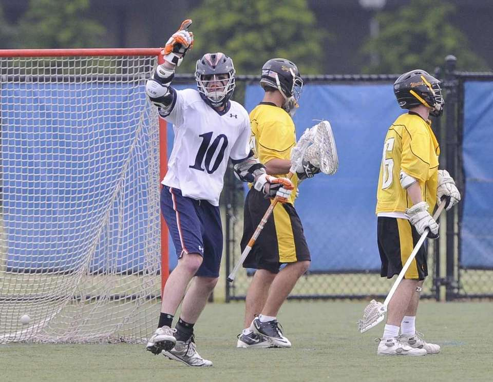 Manhasset attacker Joe Mancini reacts after scoring against