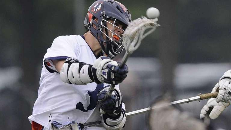 Manhasset midfielder Ryan Matthews shoots and scores against