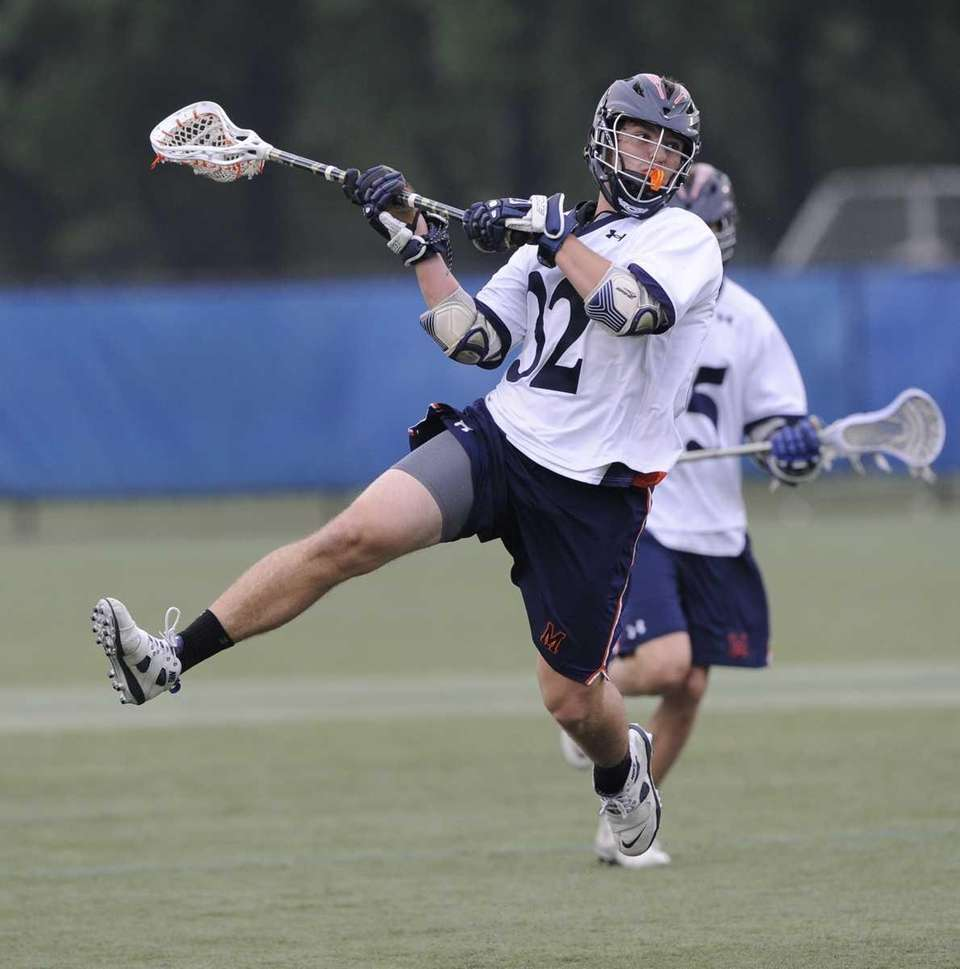 Manhasset midfielder Harry Kucharczyk shoots and scores against