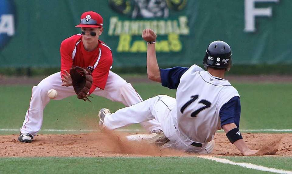 St. Dominic's Nick Pedriata #17 slides safely into