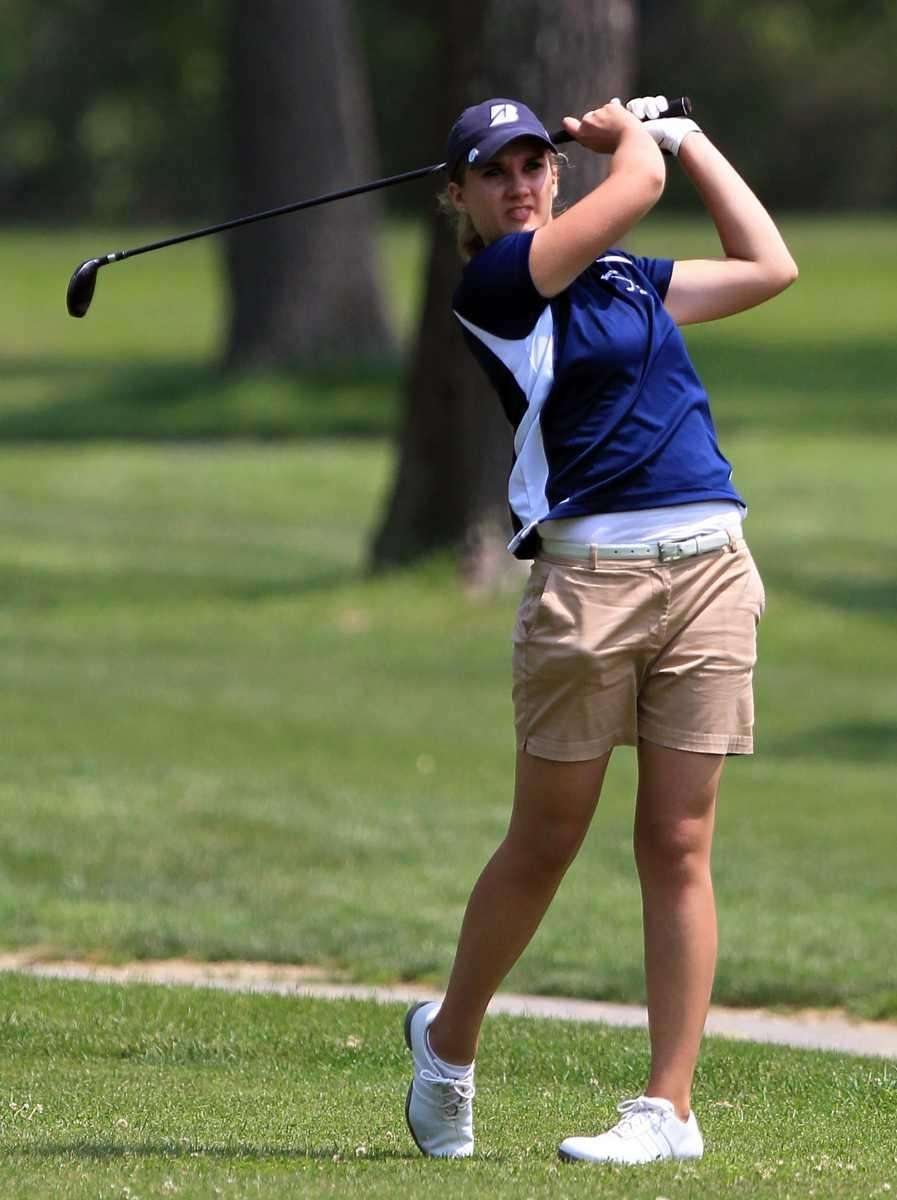 Northport's Krissy Unger follows through on her tee