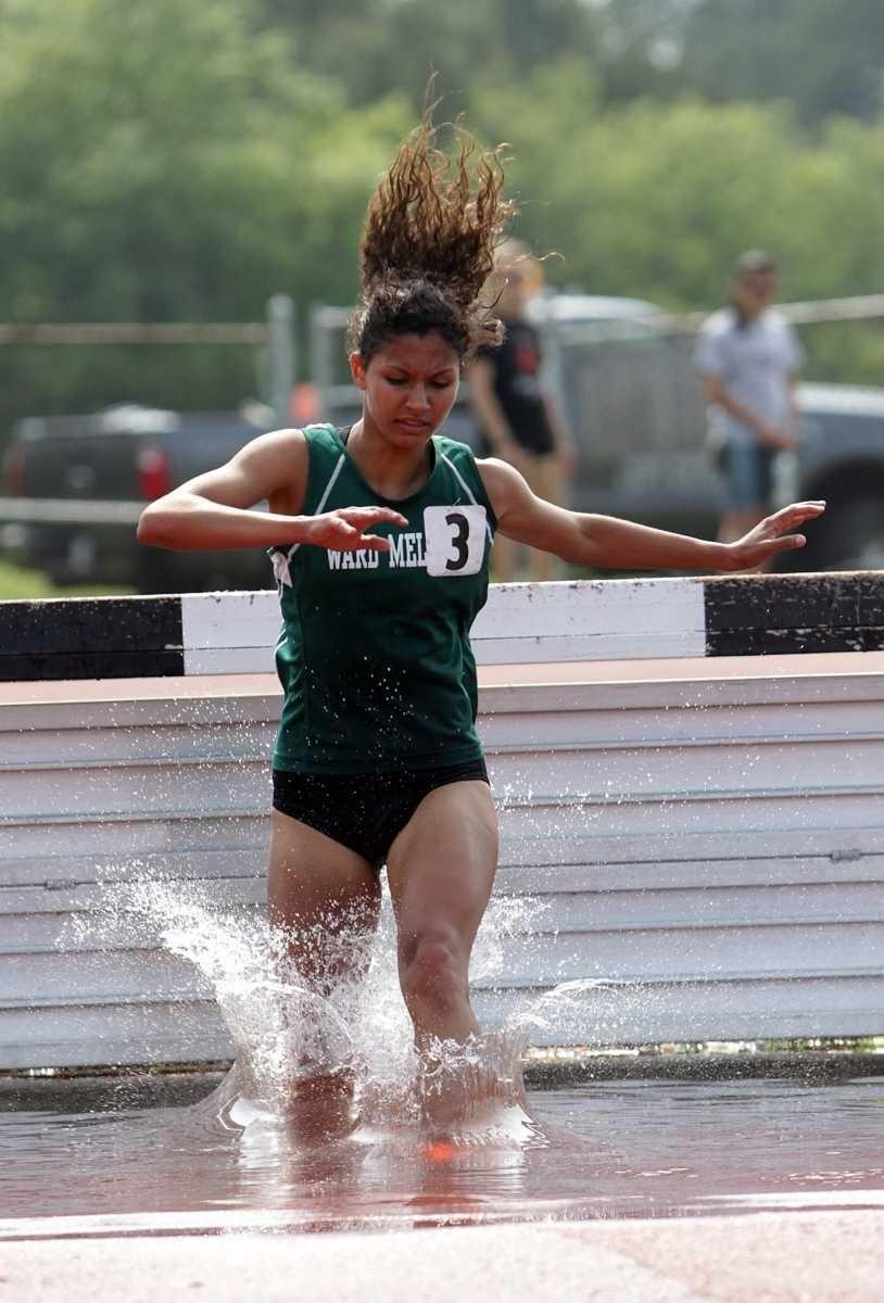 Ward Melville's Juliana Marcucci (3) jumps the final