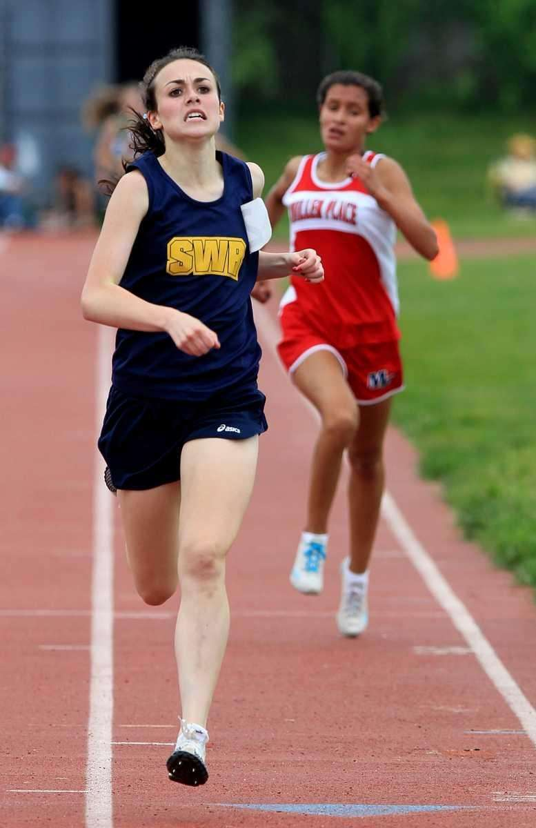 A determined Shannon McDonnell of Shoreham-Wading River finishes