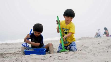 Brothers Giovanni Giua, 5, right, and Edoardo, 5,