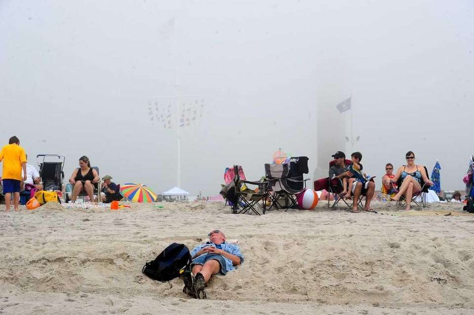 People congregate at Jones Beach on Friday to