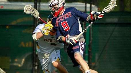 Smithtown West's Joseph Ryan (9) cuts around Ward