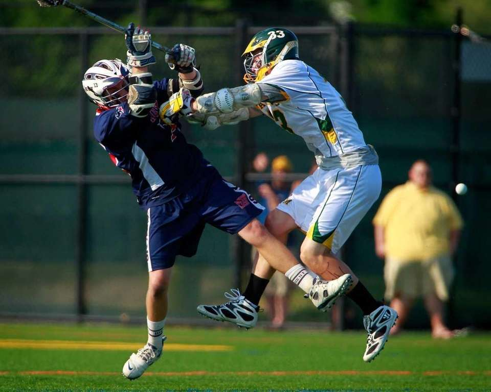 Smithtown West's Craig Madarasz, left, loses the ball