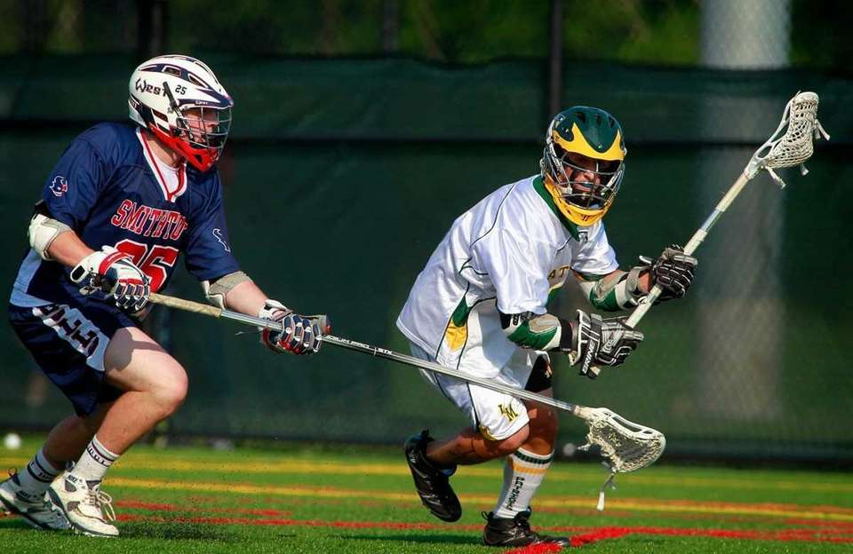Smithtown West's Logan Greco, left, checks Ward Melville's