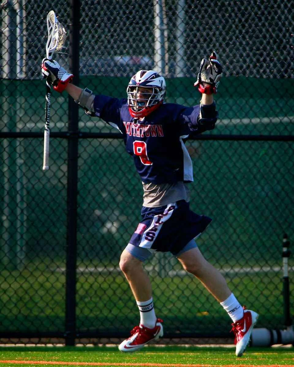Smithtown West's Joseph Ryan (9) celebrates their 15-7