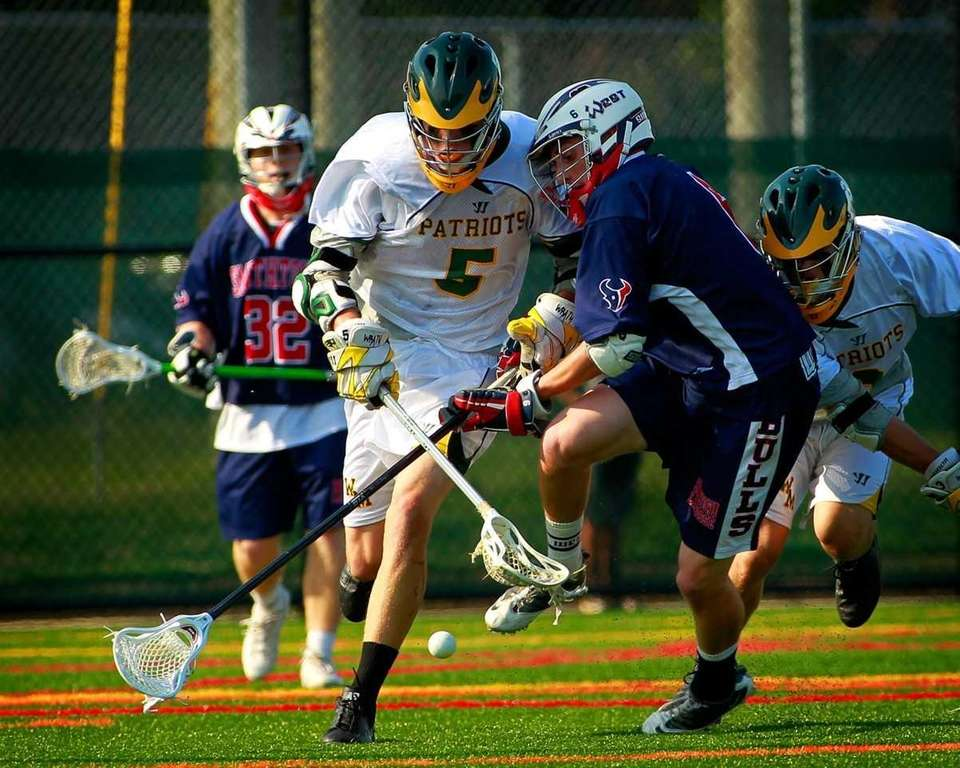 Ward Melville's John Edmonds (5) battles Smithtown West's