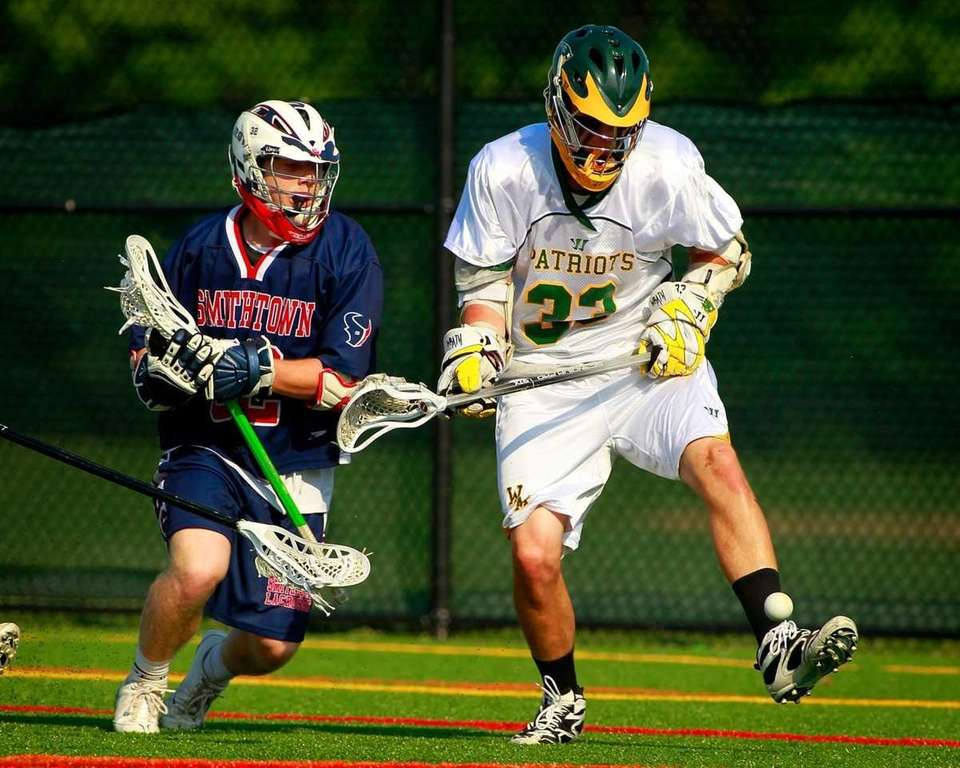 Smithtown West's James Pannell, left, battles Ward Melville's
