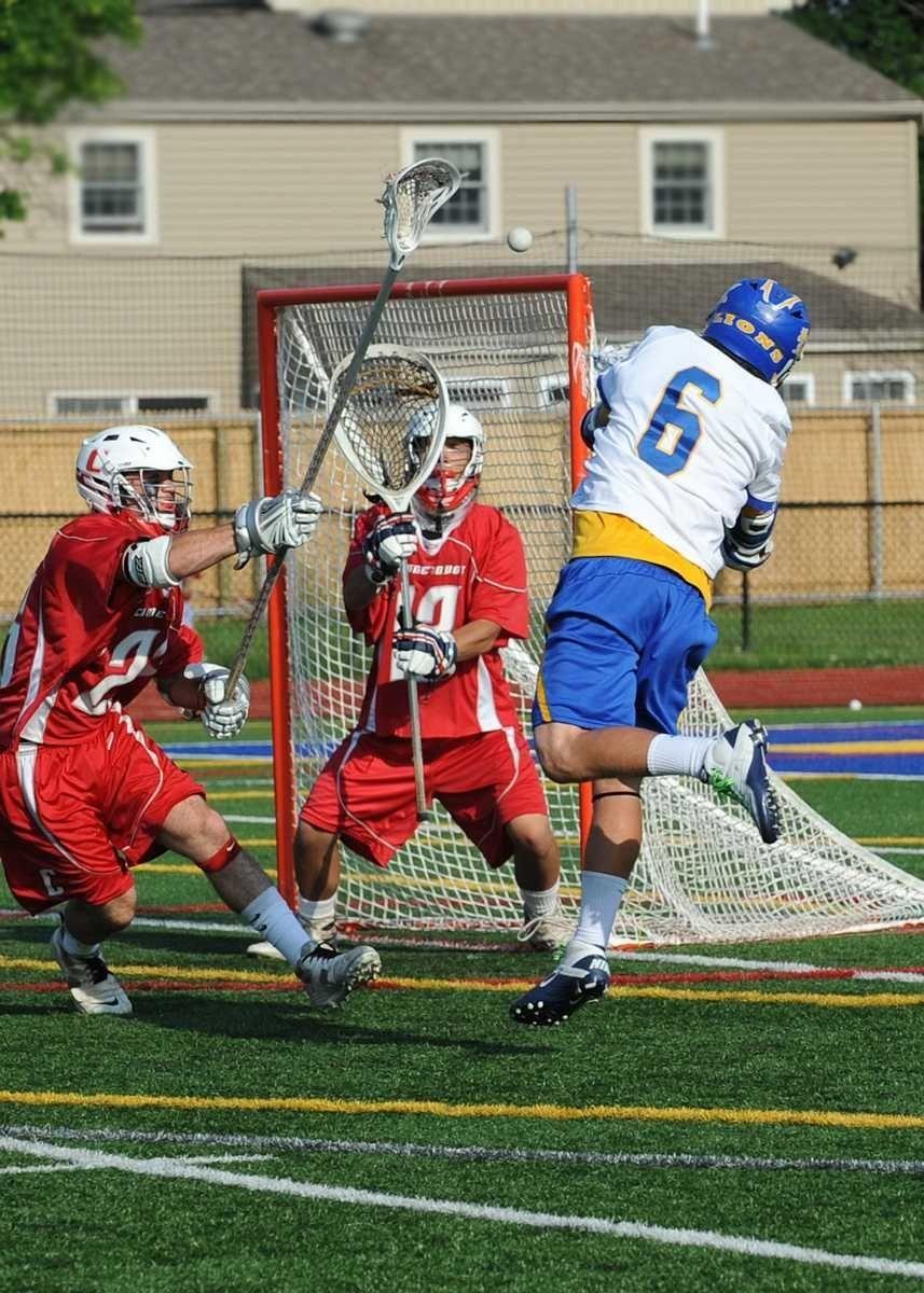 Drew Federico (6) shoots on Connetquot goalie Jake