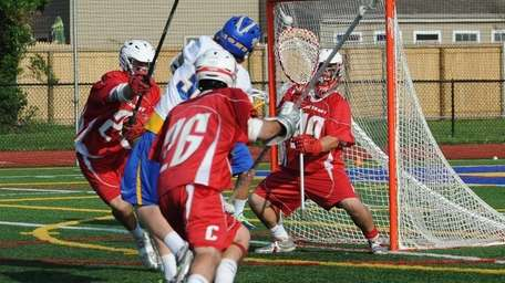 Connetquot goalie Jake Murta (29) stares at the