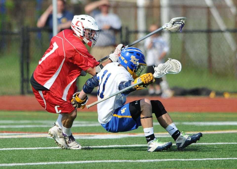 West Islip's Nick Aponte (11) takes a hard