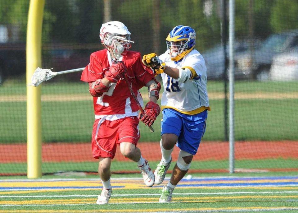 West Islip's Kyle Carrick (18) battles Connetquot's Craig