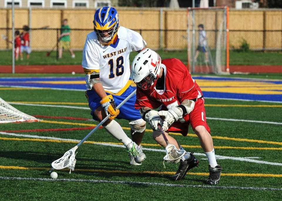 West Islip's Kyle Carrick (18) battles on defense
