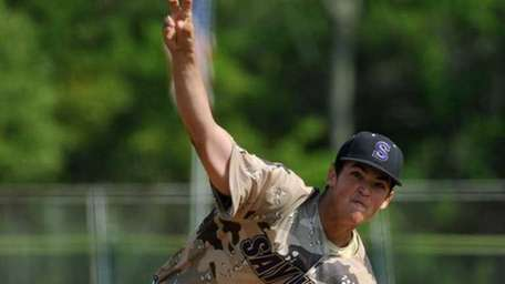 Sayville senior Nick Petrella throws a pitch during