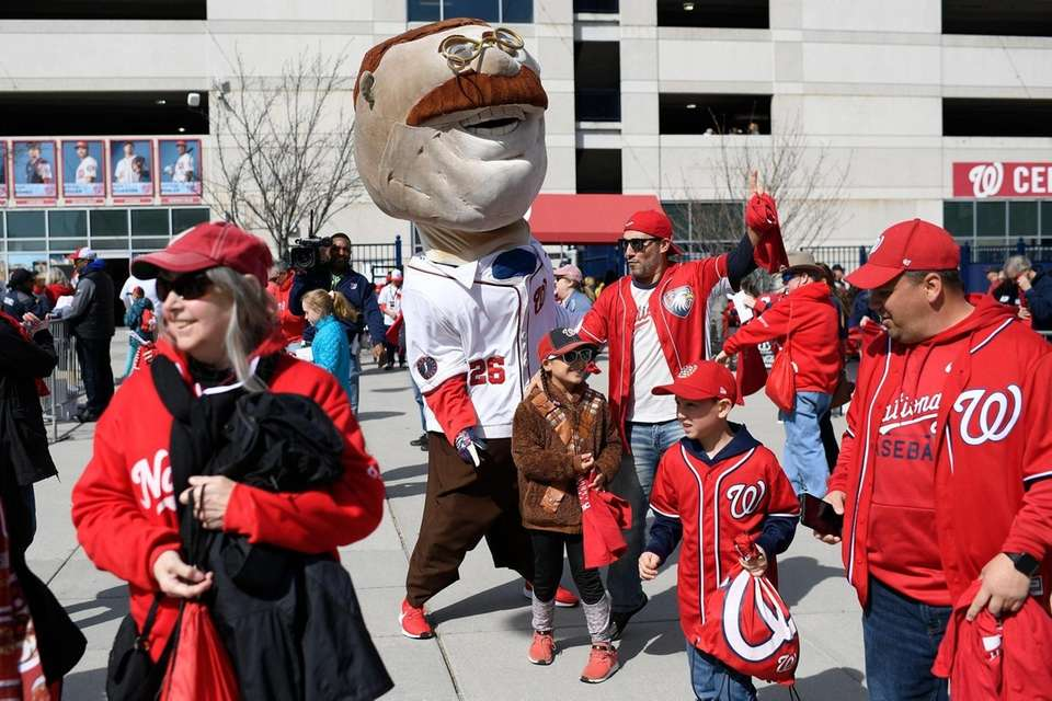 Teddy, one of the racing presidents, greets fans