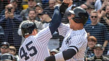 Yankees DH Luke Voit celebrates with Aaron Judge