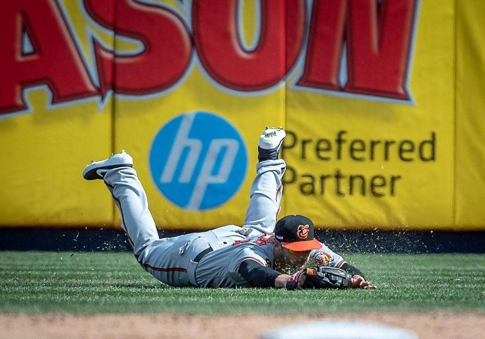 Baltimore Orioles' Joey Rickard makes a fly ball