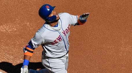 Robinson Cano #24 of the Mets celebrates after