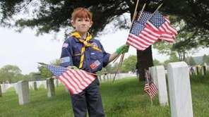 Cub Scout John Kelhetter Jr., 7, of Lynbrook