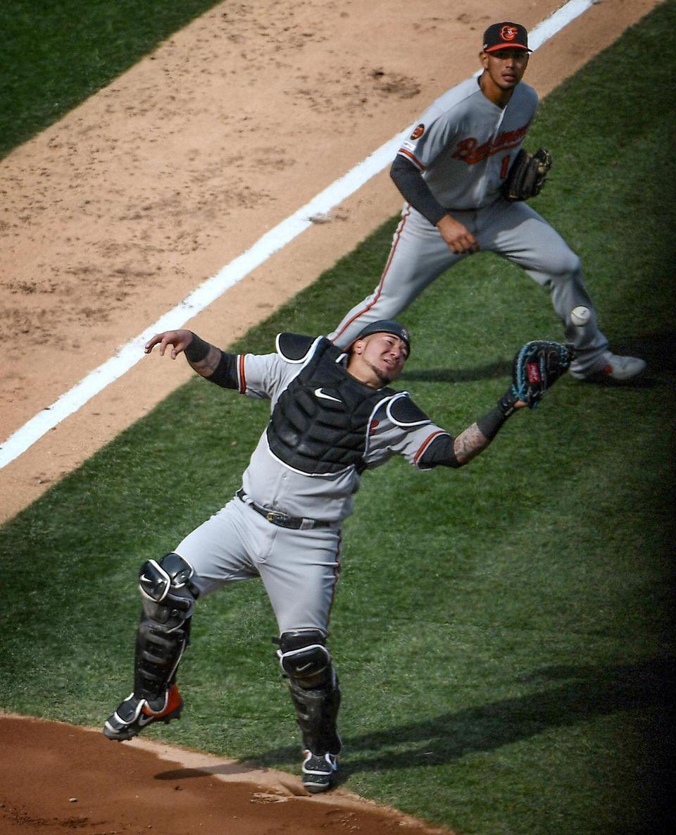 Baltimore Orioles catcher Jesus Sucre drops a pop