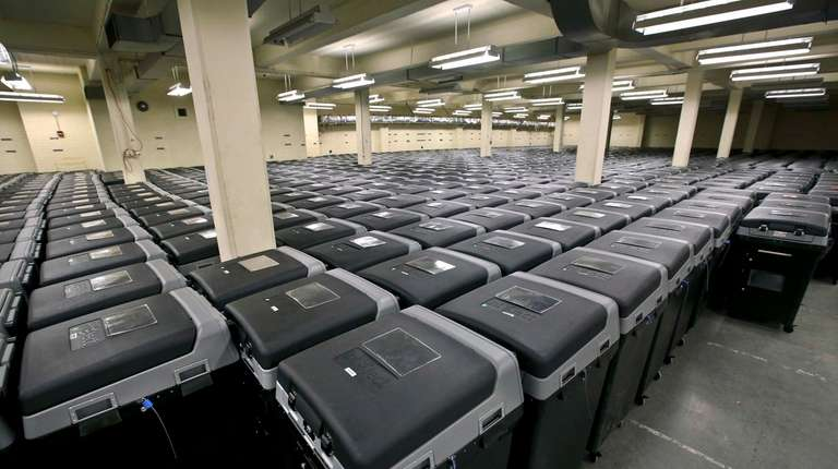Rows and rows of electronic voting machines are