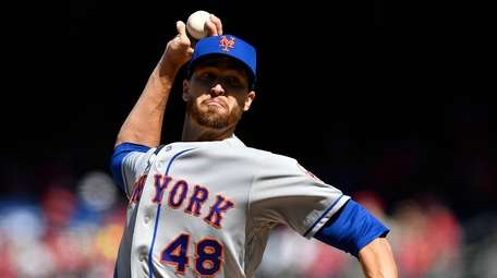 Jacob deGrom #48 of the Mets pitches in