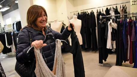 Customer Susan Ehrlich of Melville browses through formal