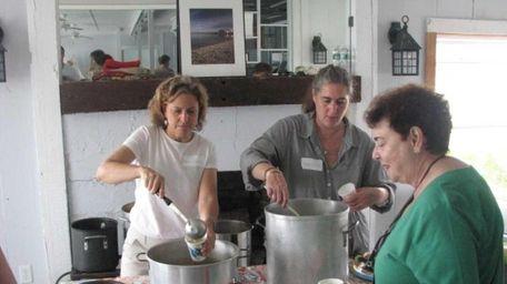 Volunteers Barbara Zegarek and Sarah Goldman serve up