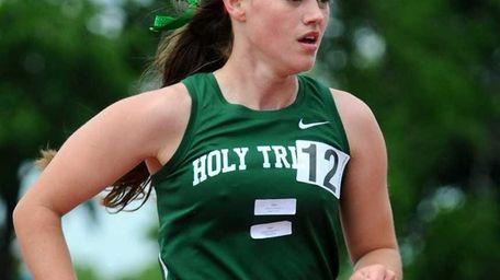 Holy Trinity High School senior Colleen Schmidt races