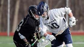 Smithtown West 's Conor Caalderone (10) controls the