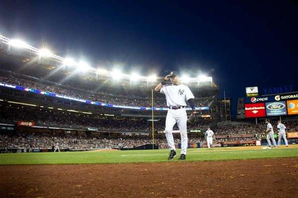Derek Jeter walks back toward the dugout at