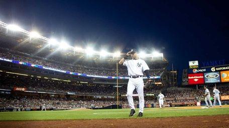 Derek Jeter walks back toward the dugout at
