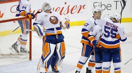Islanders goaltender Robin Lehner celebrates after the Islanders