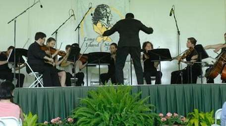 Conductor Daniel Boico leads the Long Island Mozart