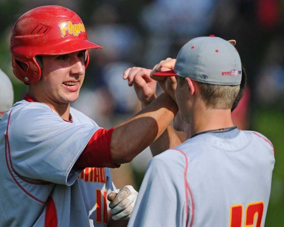 Chaminade High School designated hitter Shaun Caulfield, left,