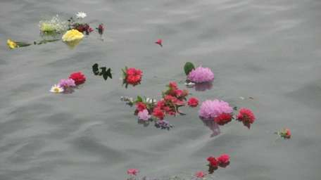 Flowers float on the current after being thrown