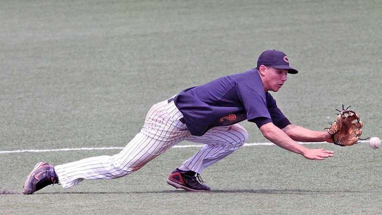 Carey third baseman Steven Marino knocks the ball