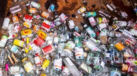 Glass bottles and jars are collected in the