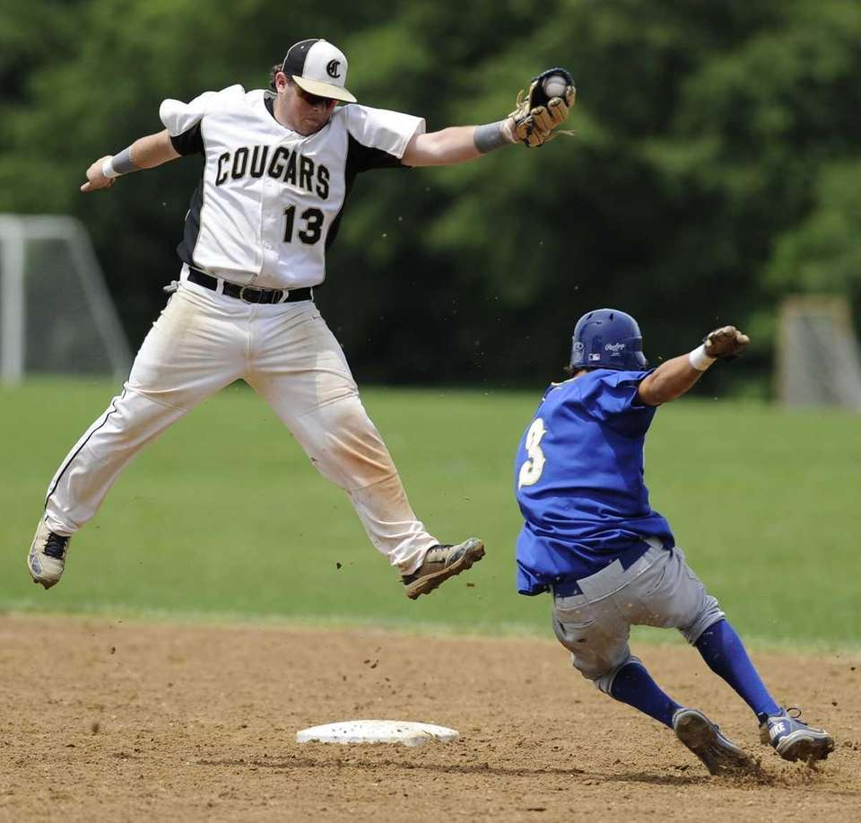Commack's Rocco Pepe leaps to corral the throw