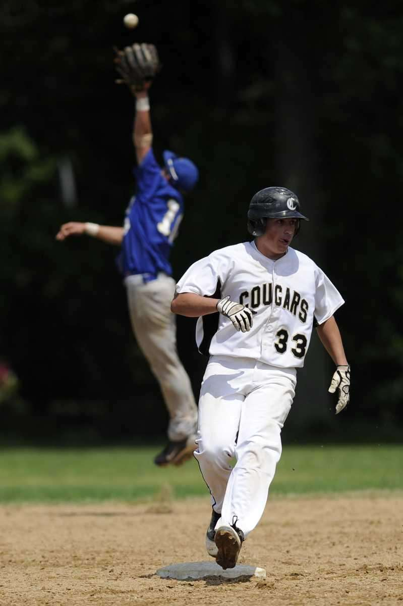 Commack's Mike Sparacino hits an RBI double against