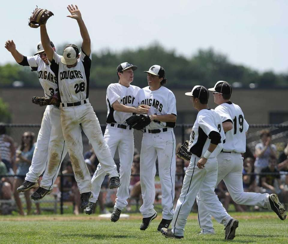 Commack players celebrate their 2-1 win over West