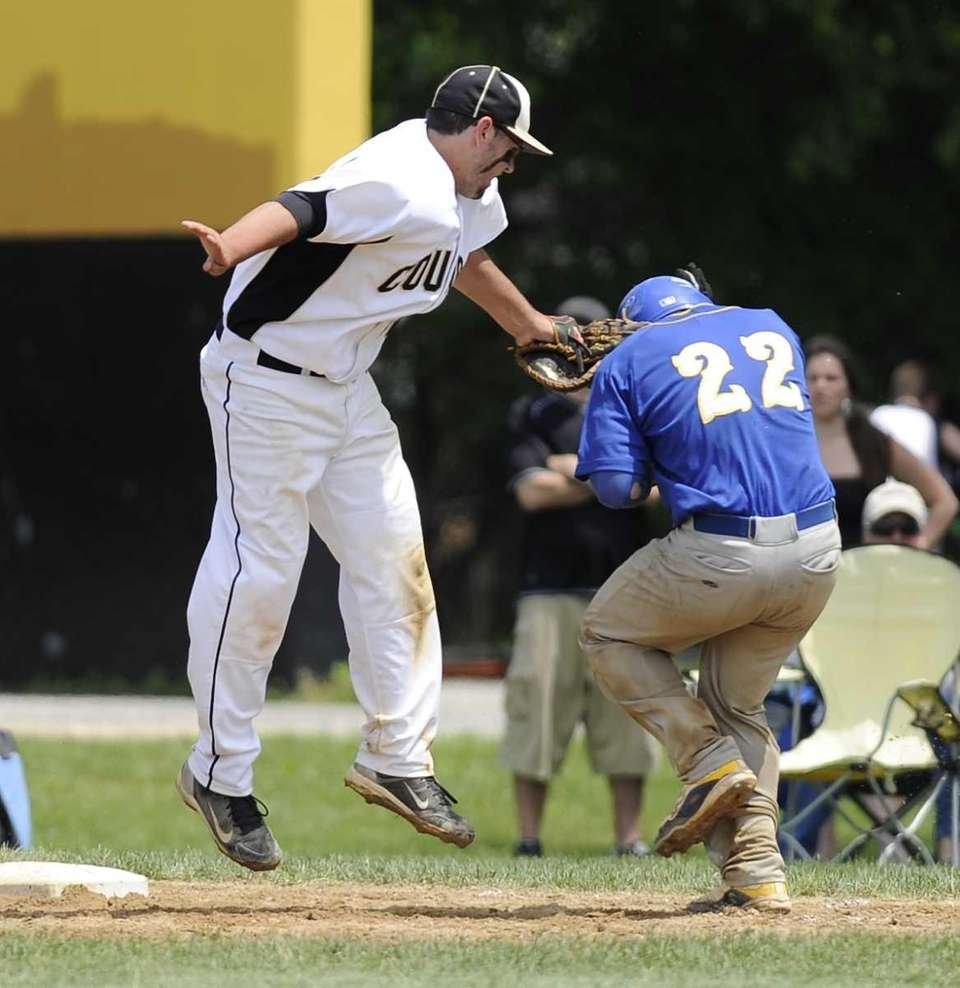 Commack first baseman Chris Baltera tags out West