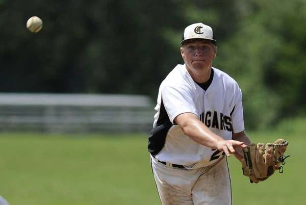 Commack's Paul Maline throws to first base for