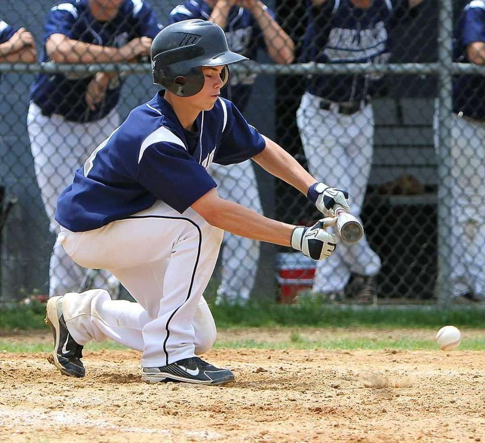 Eastport-South Manor's Andrew Wysocki squares to bunt against